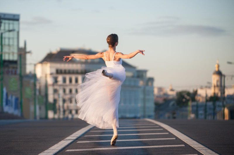 Ballerina dancing in the center of Moscow in the morning