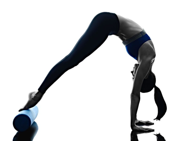 woman pilates roller exercises fitness isolated