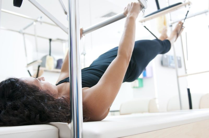 Attractive young lady doing pilates